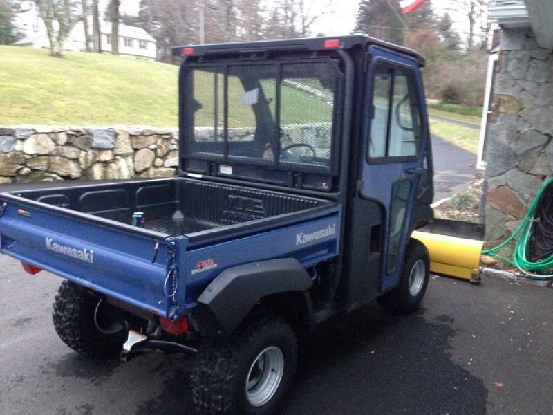 2010 Kawasaki Mule 4010 4X4 with cab and plow