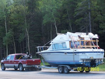 WE MOVE TRAILERS , BOATS AND EQUIPMENT !!!